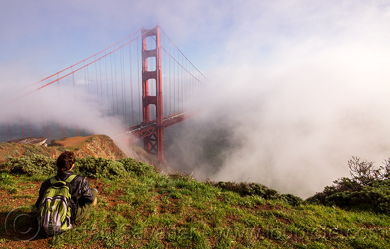 watching the golden gate bridge in the fog (san francisco), fog, golden gate bridge, grass, hill, sitting, suspension bridge, view, watching, woman, yassmine