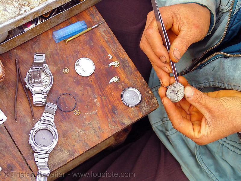 watchmaker fixing watchs - vietnam, automatic watch, fixing, hill tribes, horologist, horology, indigenous, market, mechanical watch movement, mèo vạc, orient watch, repairing, timepiece, watchmaker, wristwatch