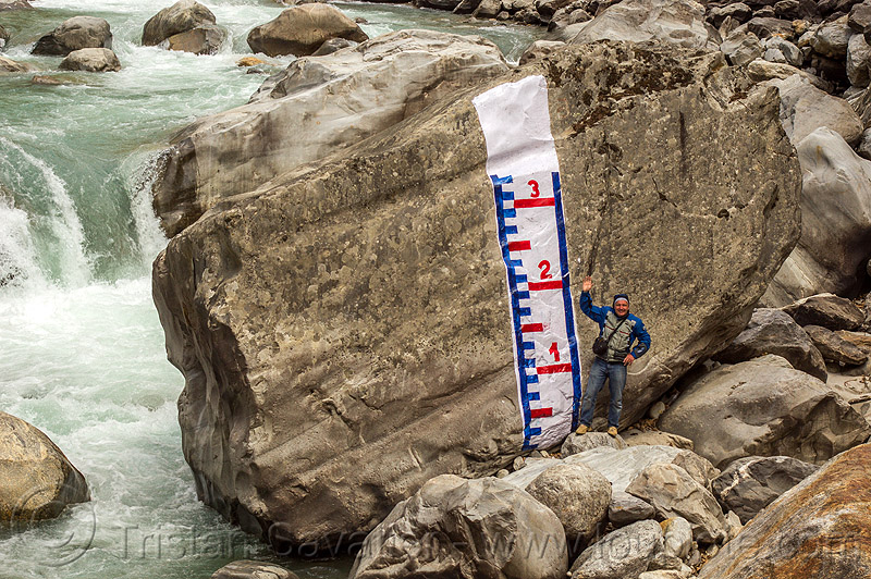water level gauge painted on huge boulder in mountain stream (india), alaknanda river, alaknanda valley, flowing, hydrometric, man, mountains, painted, staff gauge, standing, water level, whitewater