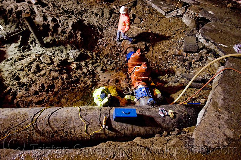 water main pipeline and cutoff valves - sinkhole - utility workers fixing broken water main (san francisco), awwa c515, construction workers, cut-off valves, gate valves, hetch hetchy water system, high-visibility vest, infrastructure, night, reflective vest, repairing, resilient, safety helmet, safety vest, sfpuc, sink hole, utility crew, utility workers, water department, water main, water pipe, working