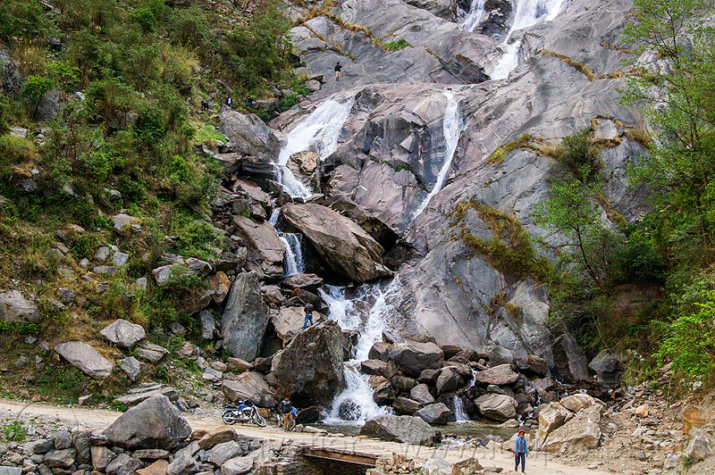 waterfall in the kali gandaki valley (nepal), annapurnas, cascade, cliff, dirt road, falls, kali gandaki valley, motorcycle, mountain road, rock, unpaved, waterfall
