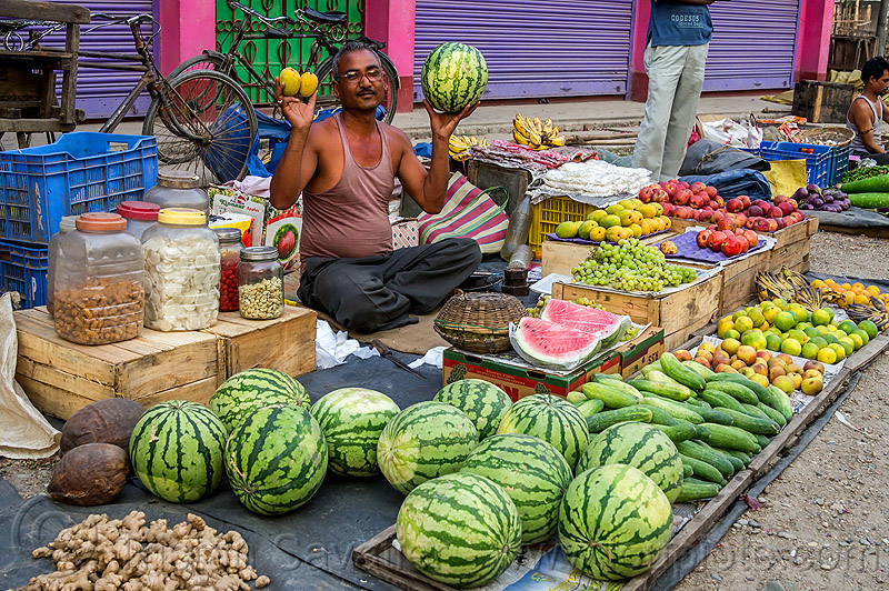 watermelons, cucumbers and fruits at street market (india), cross-legged, cucumbers, farmers market, fruits, gairkata, ginger, india, man, produce, sitting, stall, street market, street seller, vegetables, veggies, vendor, water melons, west bengal