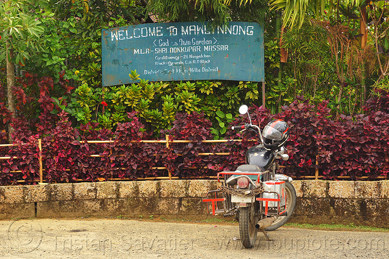 welcome to mawlynnong sign (india), east khasi hills, mawlynnong, meghalaya, motorbike touring, motorcycle touring, parked, parking, royal enfield bullet, sign, thunderbird, welcome