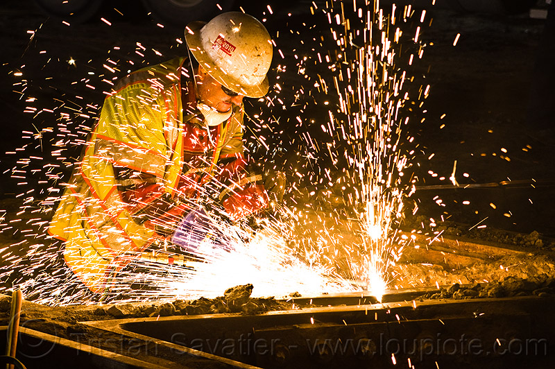 welder cutting a track rail with a oxy-acetylene torch, construction, cutting torch, helmet, high-visibility jacket, high-visibility vest, light rail, man, muni, night, ntk, oxy-acetylene cutting, oxy-acetylene cutting torch, oxy-fuel, oxy-fuel cutting, people, railroad, railroad construction, railroad tracks, rails, railway, railway tracks, reflective, reflective jacket, reflective vest, safety glasses, safety helmet, safety vest, san francisco municipal railway, sparks, track maintenance, track work, worker, working