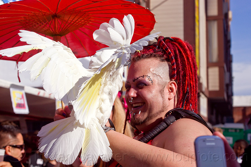 white parrot - umbrella cockatoo, cacatua alba, dreads, feathers, folsom street fair, man, pet bird, red dreadlocks, red hair, white parrot