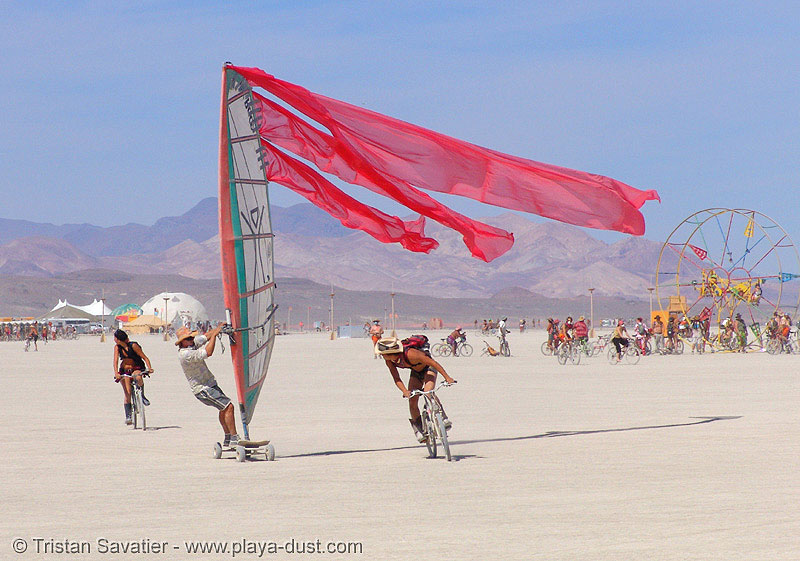 windsurfing on the playa - landsailing - burning man 2005, burning man, landsailing, streamer flags, streamers, street sailing, windsurfing