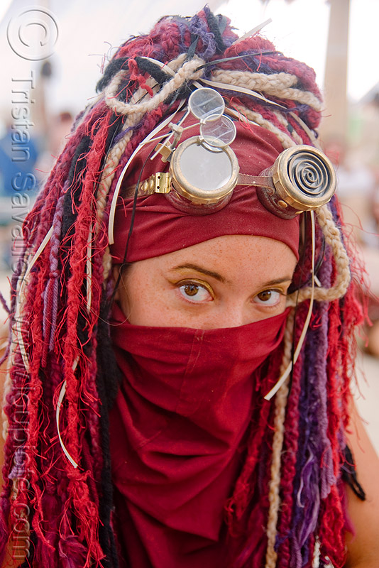 woman burner at center camp cafe - sarah walker - burning man 2009, burning man, loupes, magnifiers, magnifying glasses, sarah walker, steampunk, woman