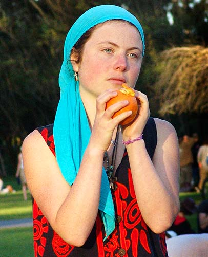 woman holding an orange (san francisco), blue, lena, orange fruit, red, woman