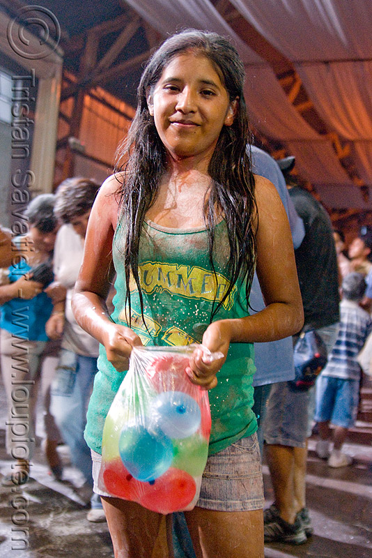 woman holding water balloons for carnival - jujuy capital (argentina), andean carnival, argentina, child, jujuy capital, kid, little girl, noroeste argentino, san salvador de jujuy, water balloons