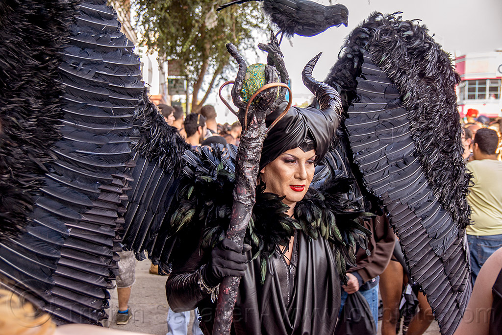 woman in black angel costume - feather wings, angel costume, angel wings, black angel, black bird, black feathers, ceremonial staff, ceremonial stick, folsom street fair, horns, woman