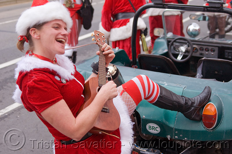 woman in santa costume playing ukulele, catie, christmas, costumes, dune buggy, guitar, people, santa claus, santacon, santarchy, santas, volkswagen