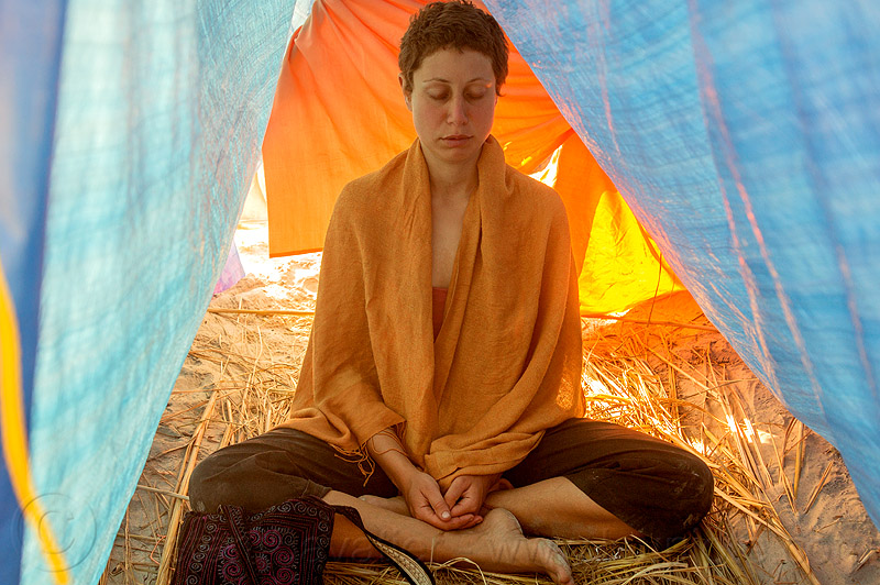 woman in yoga meditation, amal, cross-legged, eyes closed, kumbha mela, maha kumbh mela, meditating, meditation, rainbow camp, sitting, tarps, tent, woman, yoga
