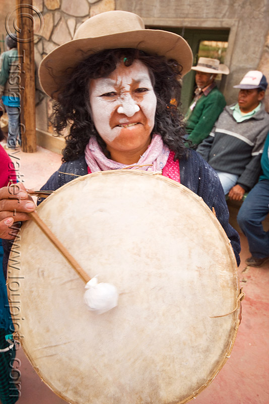 woman playing traditional andean caja drum, abra pampa, andean carnival, carnaval, drummer, drumming, folklore, gaucho, hat, music, noroeste argentino, old, people, quebrada de humahuaca