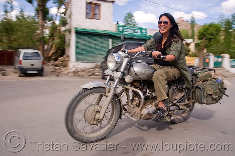 woman riding royal enfield bullet motorcycle - grace liew (india), 350cc, grace, ladakh, motorbike touring, motorcycle touring, motorcyclist, rider, riding, royal enfield bullet, street, woman