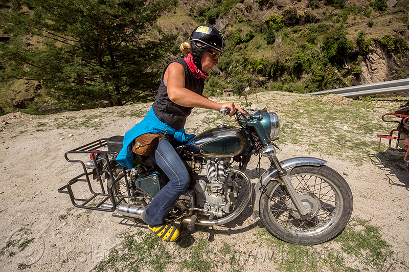 woman riding royal enfield bullet motorcycle (india), alaknanda valley, kick start, kicking, kickstarting, motorbike touring, motorcycle touring, mountains, riding, royal enfield bullet, woman