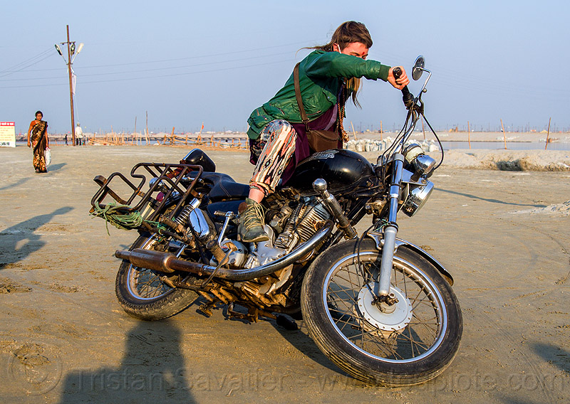 woman riding royal enfield bullet thunderbird motorcycle, 350cc, bun bun, falling, hindu pilgrimage, hinduism, india, maha kumbh mela, motorcycle touring, motorcyclist, rider, riding, royal enfield bullet, thunderbird, woman