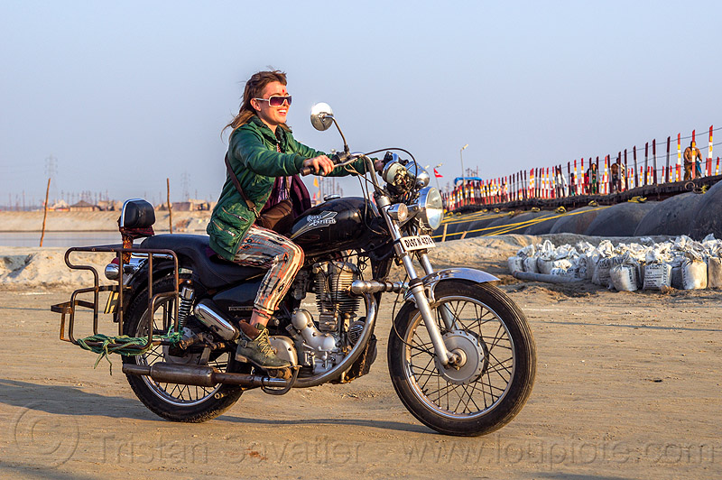 woman riding royal enfield bullet thunderbird motorcycle, 350cc, bun bun, chelsea, floating bridge, ganga, ganges, ganges river, kumbh mela, kumbha mela, maha kumbh mela, motorbike, motorbike touring, motorcycle touring, motorcyclist, people, pontoon bridge, rider, sand bags