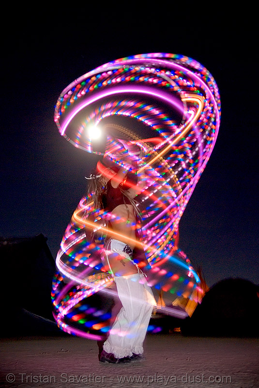 woman spinning LED hoop at night - burning man 2007, burning man, full moon, glowing, hula hoop, led hoop, led lights, light hoop, night