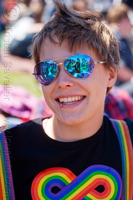 woman with blue mirror sunglasses, blue sunglasses, dolores park, gay pride festival, infinity sign, infinity symbol, jess, lip piercing, mirror sunglasses, mohawk hair, pugs sunglasses, rainbow colors, rainbow tshirt, woman