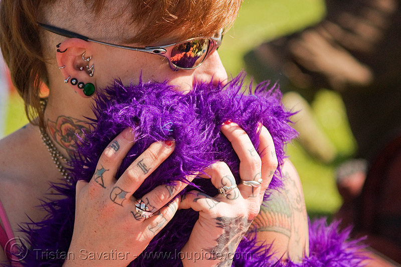 woman with ear piercings and hand tattoos - leah (san francisco), ear, fur, hands, leah, piercing, purple, sunglasses, tattooed, tattoos, woman