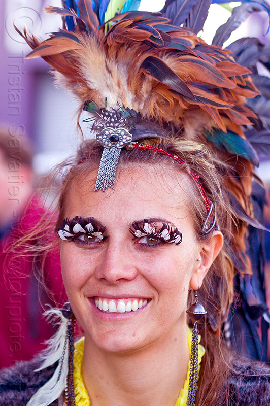 woman with feather costume and feather eyelashes, feather earrings, feather eyelashes, feather headdress, feathers, folsom street fair, woman