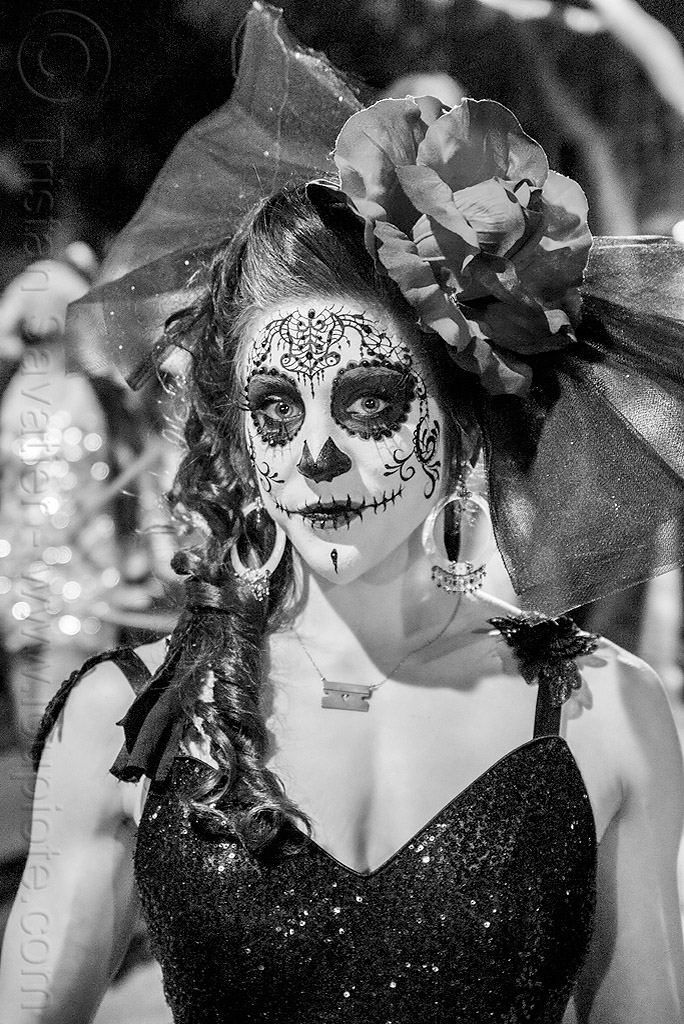 woman with intricate sugar skull makeup - black dress - headdress with large flower and veil - dia de los muertos, black dress, day of the dead, dia de los muertos, earrings, face painting, facepaint, flower headdress, halloween, night, sugar skull makeup, veil, woman