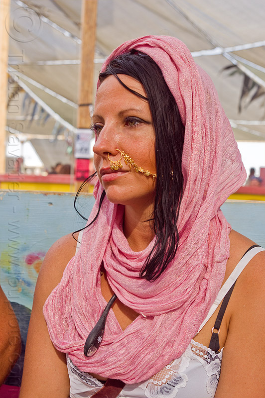 woman with nose chain - burning man 2013, burning man, gold jewelry, headdress, jill, nose chain, nose jewelry, nose piercing, nose ring, nostril piercing, pink scarf, woman