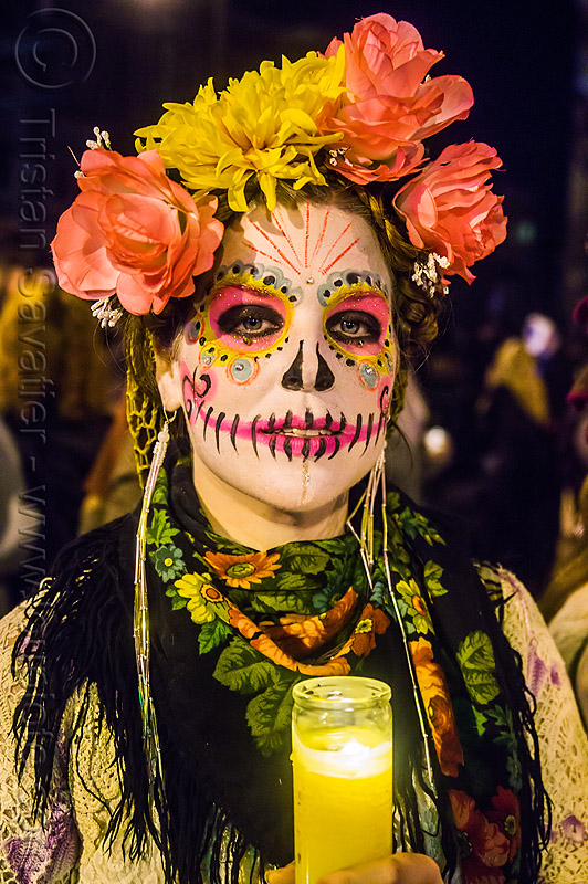 woman with pink sugar skull makeup - dia de los muertos (san francisco), candle, day of the dead, dia de los muertos, face painting, facepaint, flower headdress, flowers, halloween, night, sugar skull makeup, woman