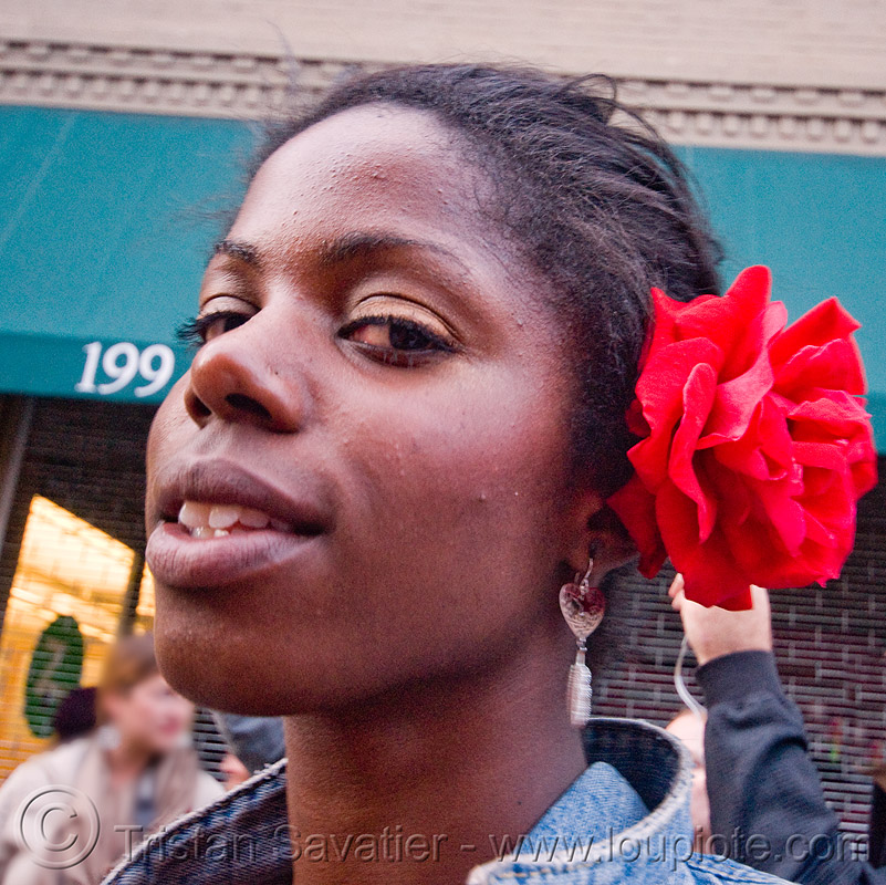 woman with red flower in hair - how weird street faire (san francisco), african american woman, black woman, how weird festival, red flower, red rose, rose flower