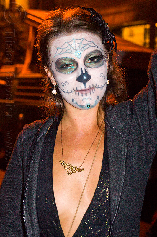 woman with skull makeup - dia de los muertos, brass necklace, day of the dead, dia de los muertos, face painting, facepaint, halloween, night, snakes necklace, sugar skull makeup, woman