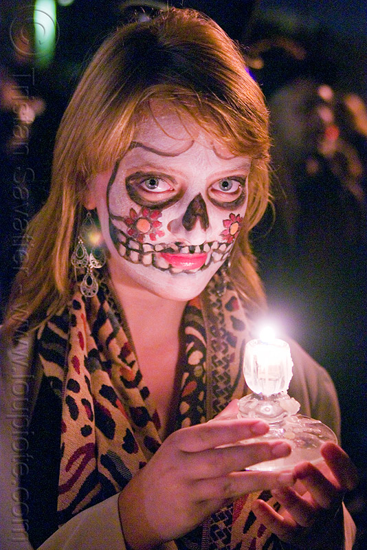 woman with skull makeup holding candle - Día de los muertos - halloween (san francisco), candle light, day of the dead, dia de los muertos, face painting, facepaint, night, people, sugar skull makeup
