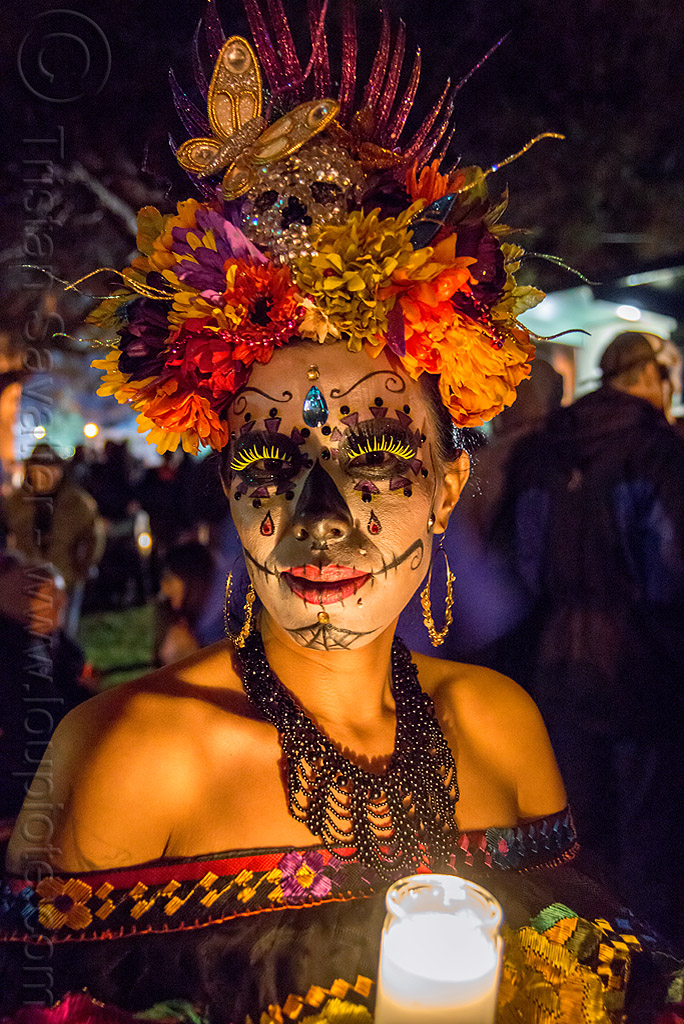 Woman With Sugar Skull Makeup And Elaborate Flower