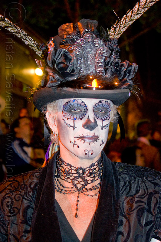 woman with sugar skull makeup and victorian costume, black necklace, black outfit, cameragirl, day of the dead, decorated hat, dia de los muertos, face painting, facepaint, feathers, halloween, heather, lace, night, people, stovepipe hat, victorian outfit