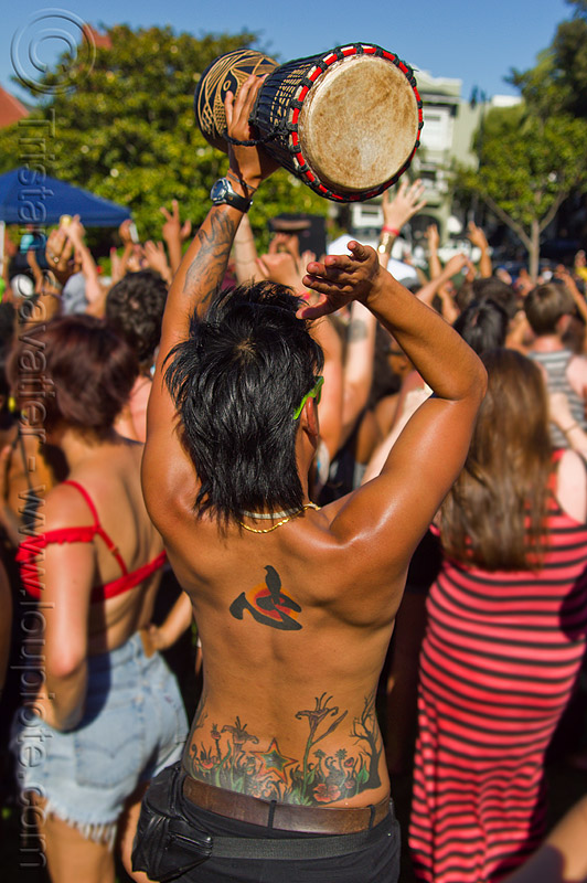 woman with tattooed back playing djembe drum, back tattoo, dolores park, drumming, gay pride, gay pride festival, jenn, people, tattoos