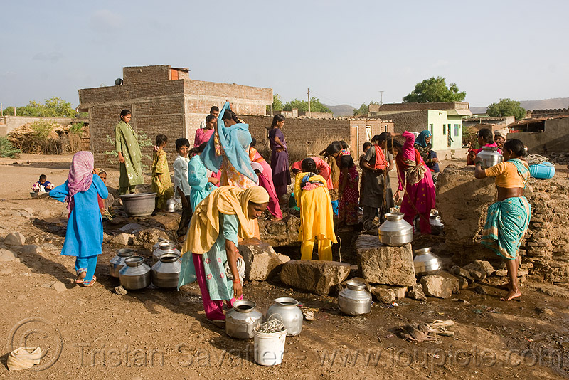 women around village water well - ajanta (india), ajanta, communal water well, crowd, india, metal jars, water jars, women