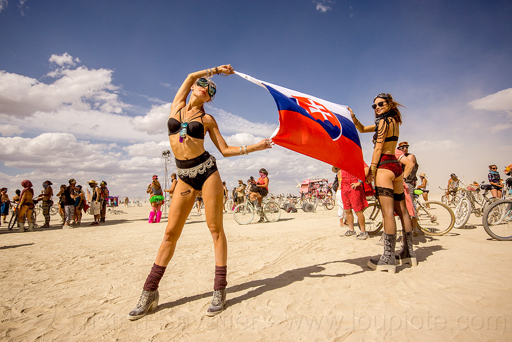 women holding slovakia flag - burning man 2015, burning man, flag, holding, slovakia, women