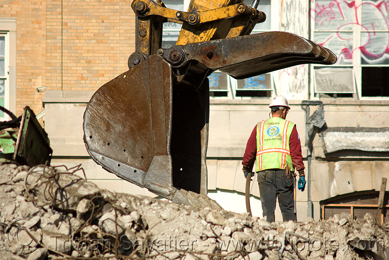 worker near excavator bucket - building demolition, abandoned building, abandoned hospital, at work, bucket attachment, building demolition, caterpillar, construction worker, excavator bucket, excavators, heavy equipment, hydraulic, machinery, man, presidio hospital, presidio landmark apartments, rubble, working
