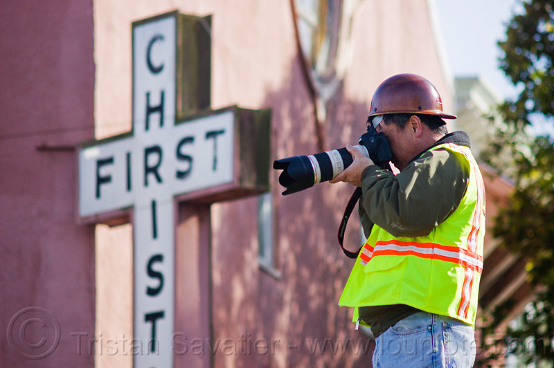 worker taking photos on construction site, camera, christ, construction worker, cros, duboce, first, high-visibility jacket, high-visibility vest, light rail, man, muni, ntk, photographer, railroad construction, railroad tracks, railway tracks, reflective jacket, reflective vest, safety helmet, safety vest, san francisco municipal railway, sign, track maintenance, track work