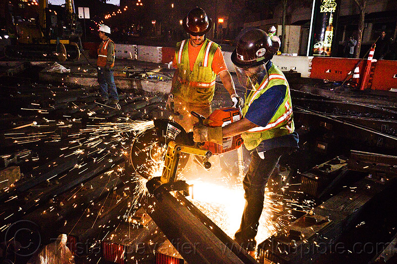 workers cutting rail with cut-off saw, 3120x, abrasive saw, cut-off saw, cutting, high-visibility jacket, high-visibility vest, huskvama, light rail, men, muni, night, ntk, power tool, railroad construction, railroad tracks, rails, railway tracks, reflective jacket, reflective vest, safety gloves, safety helmet, safety vest, safety visor, san francisco municipal railway, sparks, track maintenance, track work, workers, working