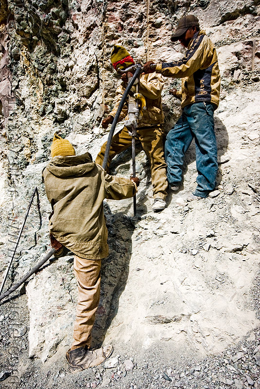 workers using pneumatic drill - drilling and blasting - road construction - ladakh (india), drilling and blasting, fuses, fuzes, groundwork, jackhammer, ladakh, pneumatic drill, road construction, roadworks, rock, workers, working
