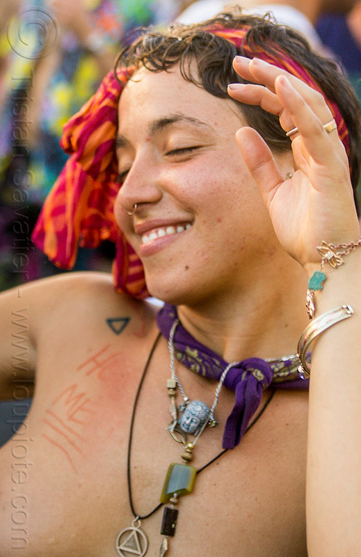 yassmine dancing at decompression 2014 (san francisco), bandana, bracelets, burning man decompression, dancing, headband, hippie, jewelry, necklaces, nose piercing, rings, septum piercing, woman, yassmine