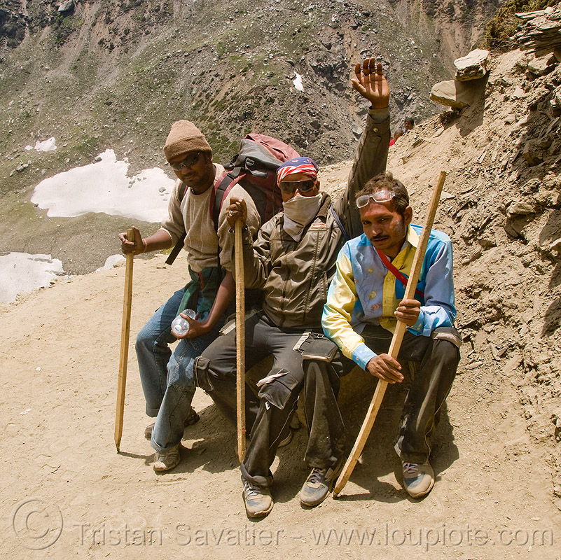yatris (pilgrims) with their walking sticks - amarnath yatra (pilgrimage) - kashmir, hiking canes, mountain trail, mountains, people, trekking, wlaking sticks, अमरनाथ गुफा