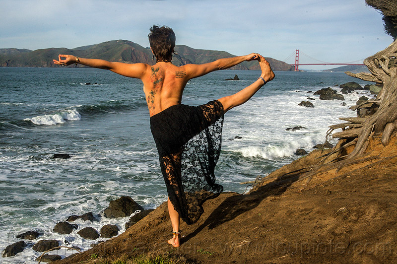 yoga - extended hand to big toe pose, balancing, black dress, black lace, butterfly tattoos, golden gate bridge, lace dress, ocean, one leg, pose, rugged, sea, seashore, shore, standing, stretching, surf, suspension bridge, white water, woman, yassmine, yoga