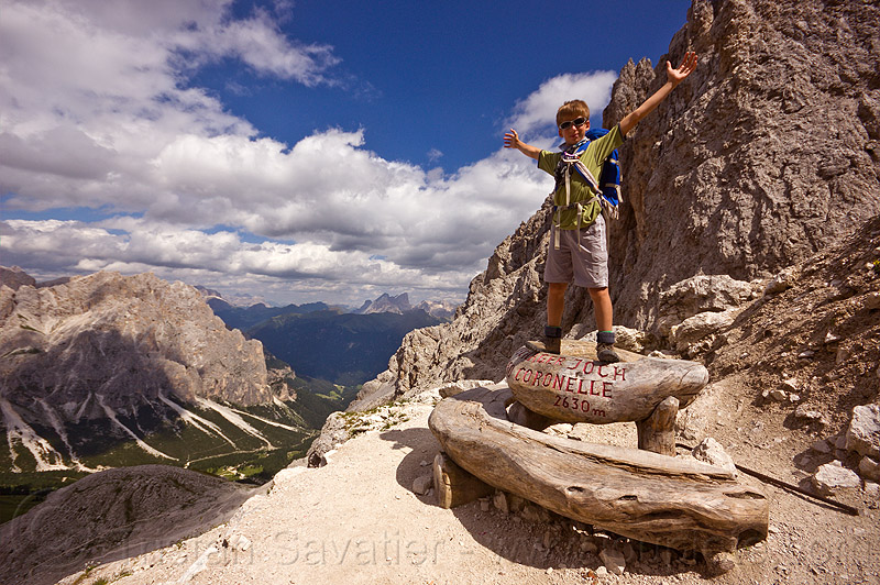 passo coronelle, alps, arms, bench, boy, dolomites, dolomiti, hiking, marker, mountaineering, mountains, passo coronelle, sign, standing, trail, trekking