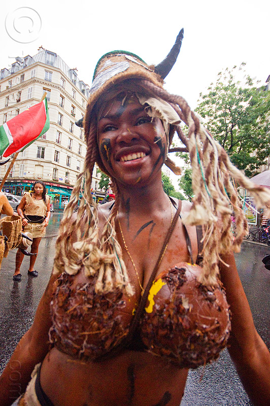 young caribbean woman wearing coconut bra - choukaj - carnaval tropical (paris), caribbean, carnaval tropical, choukaj, coconut bra, costumes, creole, créole, dancing, guadeloupe, hat, indigenous culture, parade, paris, traditional, tribal, west indies, woman