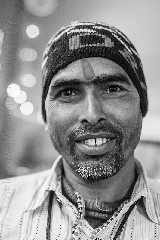 young hindu man at kumbh mela 2013 (india), beard, headdress, headwear, hindu, hinduism, knitcap, kumbha mela, maha kumbh mela, man, night, pilgrim, tilak, tilaka, yatri