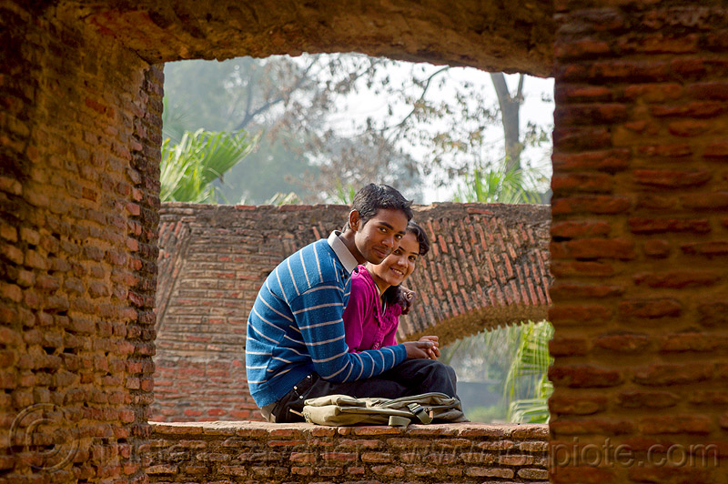 young indian couple in residency ruins - lucknow (india), brick vault, brick wall, british residency, india, lovers, lucknow, man, ruins, sitting, woman