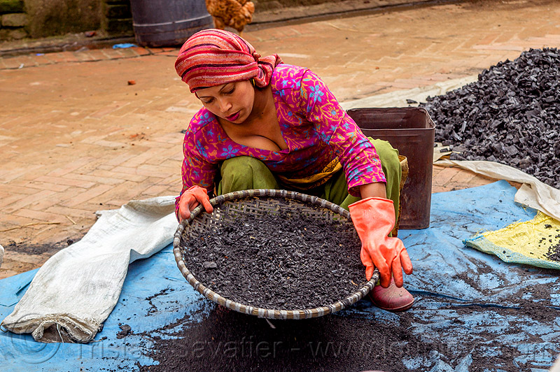 young nepali woman sifting charcoal (nepal), bhaktapur, blue, charcoal, coal, gloves, heap, sift, sifting, squatting, tarp, woman