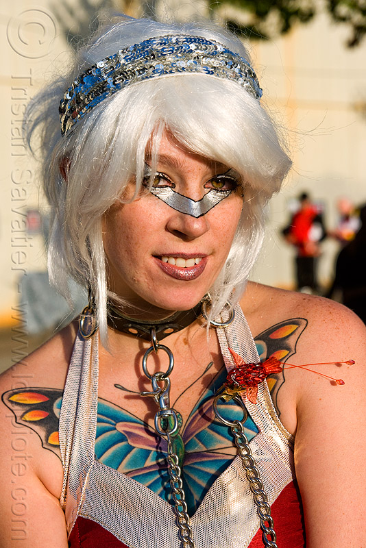 butterfly tattoo, chain, collar, islais creek promenade, lily, makeup, people, silver wig, superhero street fair, tattooed, tattoos, white wig, woman