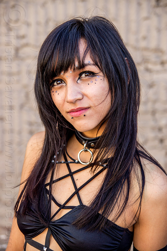 young woman with shiny black eyes, bindis, black eyes, eye makeup, eyeliner, fashion, folsom street fair, lip piercing, peircing, shiny eyes, snake bites piercing, woman